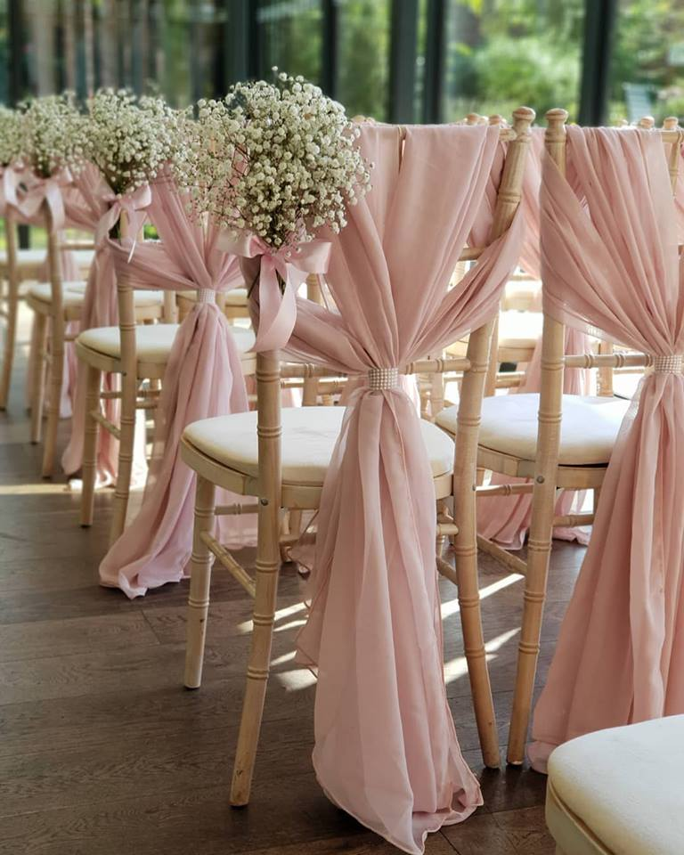 pale pink flowers chair decor for weddings